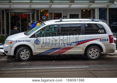 Toronto, Canada - December 21, 2016: Dodge Grand Caravan CRU 2204 from the Toronto Police in operation in Downtown
