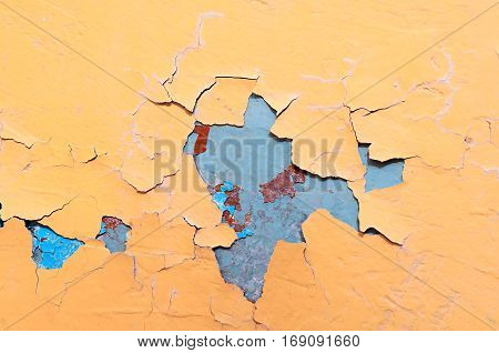 Texture background of light yellow and blue texture peeling paint on the old texture rough surface. Texture of peeling paint. Old stone texture background surface.Rough peeling paint texture background. Stone background of peeling paint texture