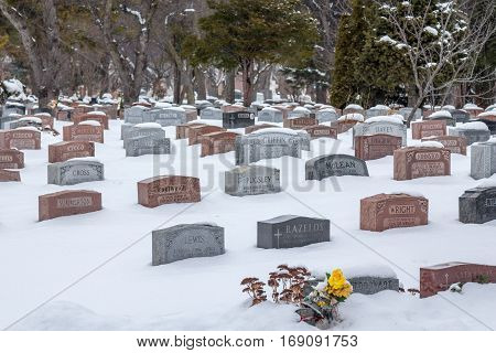 Montreal, Canada - December 23, 2016: Graves in Mount Royal Cemetery under heavy snow