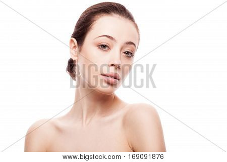 closeup portrait of young woman with clean fresh skin isolated on blue gradient background