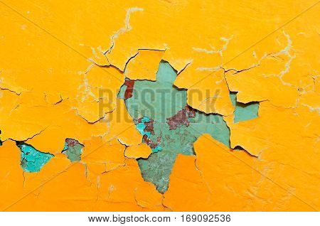 Texture background of bright yellow and blue texture peeling paint - colorful texture background. Peeling paint on the concrete wall -texture background