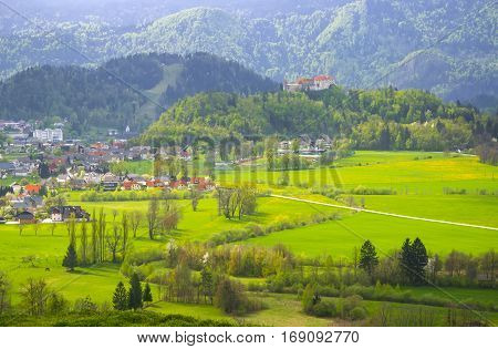Sunlit alpine valley and slovenian village at spring day near Bled, Slovenia