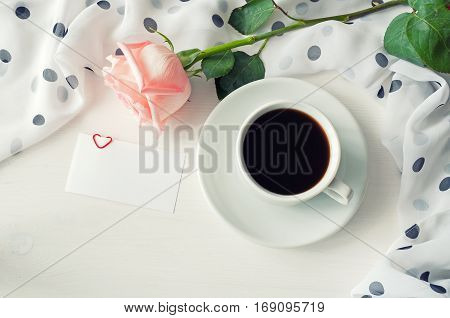 St Valentines day love romantic background - cup of coffee rose blank love card for romantic text message. Love romantic still life, romantic concept