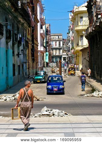 People on dilapidated street in Havana. Cuba, on June 4, 2009.