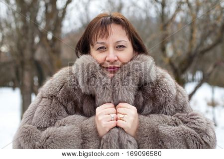 Picture of a beautiful middle aged woman wearing a mink coat