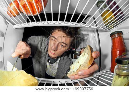man near the fridge is food 2