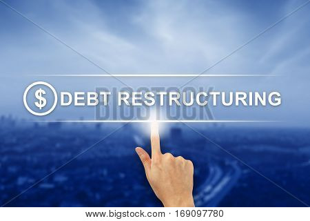 hand pushing Debt restructuring button on a virtual screen interface