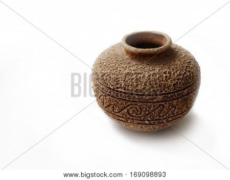 old handmade ceramic vase with rough suface and ornament