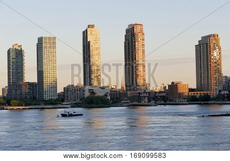 Buildings Of Long Island In Front Of East River At Twilight