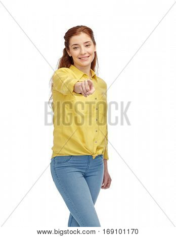 people, choice and gesture concept - happy young woman pointing finger on you over white