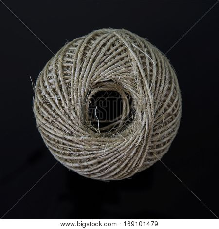 Ball of string on a black background