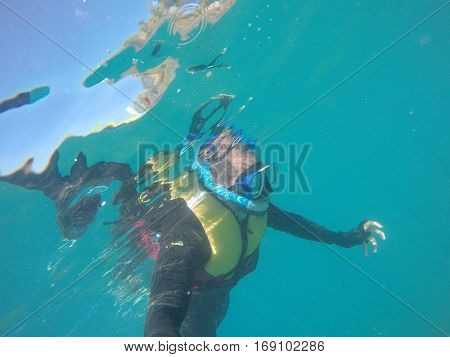 Scuba Diver Underwater taking a selfie in Whitsundays, Australia