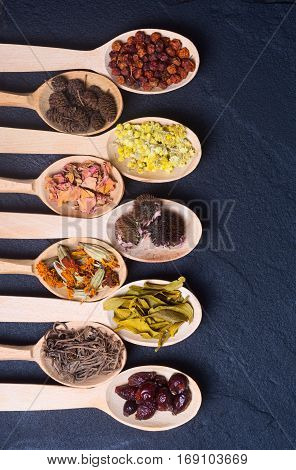 Nature medicine . Herbs in wooden spoon with spase for text .