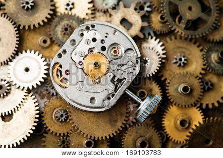 Aged clock mechanism macro vie. Retro hand watches parts on bronze gears background