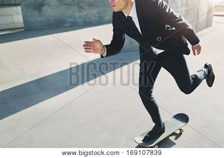 Businessman On A Skateboard Rushing To An Assembly