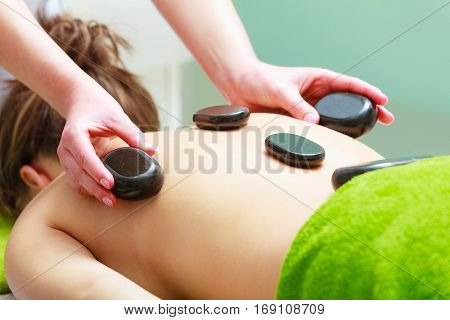 Massage With Hot Rocks Stones In Beautician
