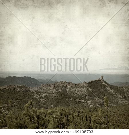 textured old paper background with landscape of Gran Canaria as seen from Pico de Las Nieves