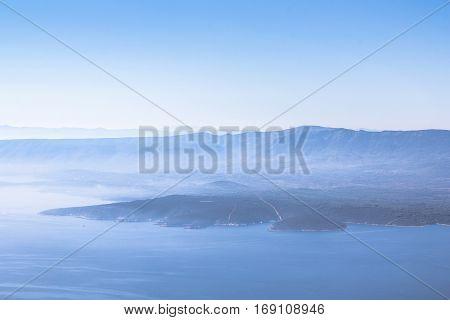 Beautiful seascape of hvar island under mystic fog mist cloud as a summer background