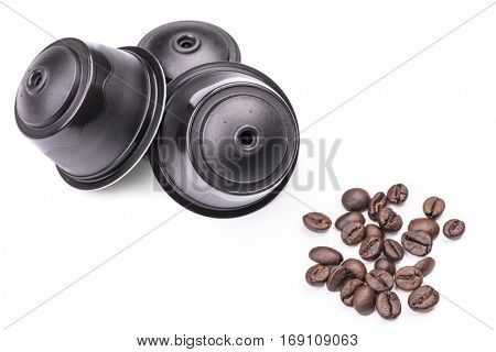 Coffee capsules and coffee beans isolated on white background