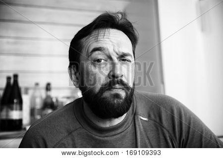 Skeptic. Black and white monochrome portrait: sad adult bearded man
