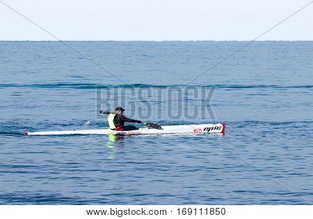 Athlete Training On Kayak Winter Morning On Sea Near Coast