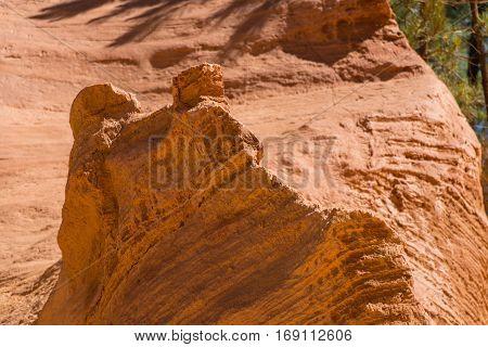Orange ochre picturesque hills. Roussillon Provence France. Preserve natural dye production - ocher.