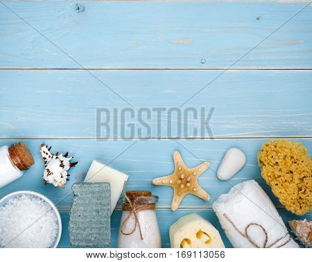 Spa resort concept on blue tropical wooden background with copyspace