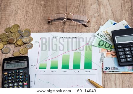 Profit concept - graph, money, euros and calculator