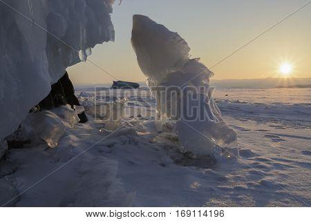 Icy Rock Of Lake Baikal At Sunrise