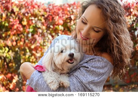 Woman walking with cute dog in park