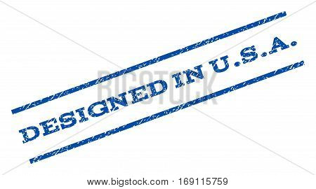 Designed In U.S.A. watermark stamp. Text tag between parallel lines with grunge design style. Rotated rubber seal stamp with scratched texture. Vector blue ink imprint on a white background.