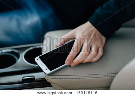 phone on the dashboard in the car