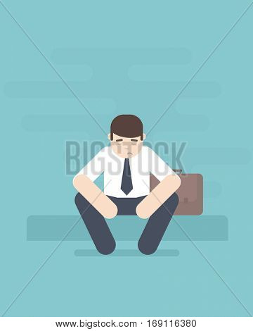 Young business man sitting in depression