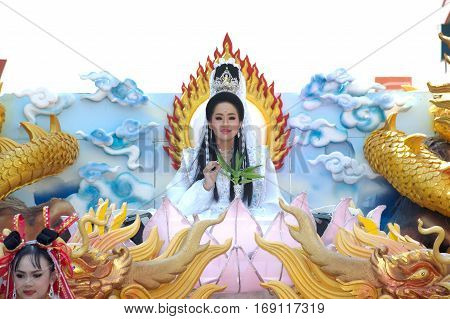 NAKHONSAWAN,THAILAND-JANUARY 1,2017 : Unidentified beautiful woman is symbol Guan Yin of God on the parade during Chinese New Year celebrations in Nakhonsawan city,Middle of Thailand.