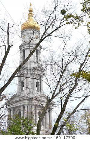 Church bell tower and the Church of the Resurrection in Ukraine. A large church with gold domes.