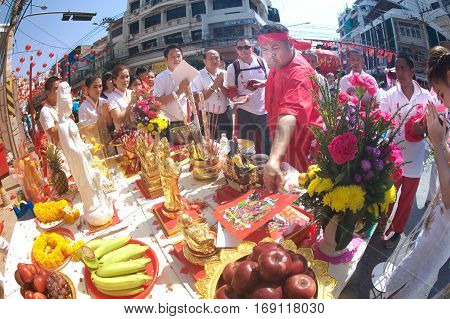 NAKHONSAWAN, THAILAND-JANUARY 31,2017 : Oracle (a medium who communicate with spirits) of gods doing ritual at worship altar table of people in Chinese New Year Celebrations in Nakornsawan Province,Thailand .