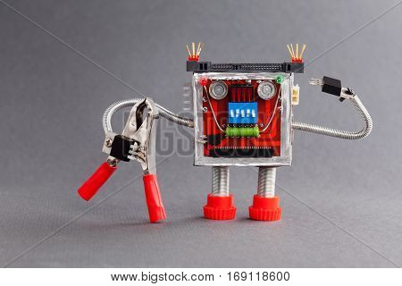 Worker ready for job. Serviceman robot character with red pliers. gray background photo