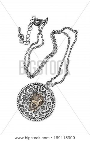 Ethnic silver medallion on a chain isolated over white