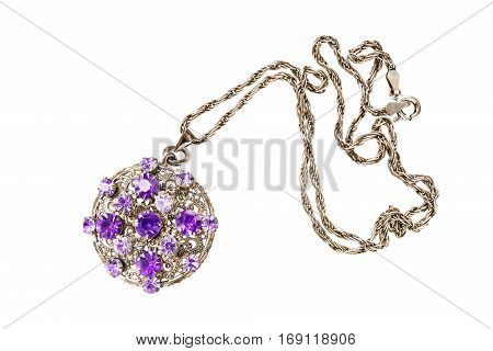 Vintage golden medallion with some amethysts on white background