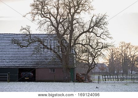 Private carport in a rural winter landscape.