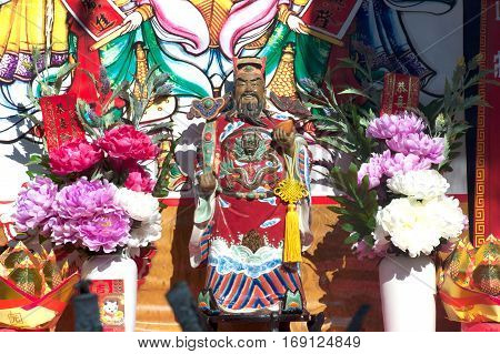 NAKHONSAWAN/THAILAND - JANUARY 31, 2017: Statue of Chinese God Guan YU on God altar table on the street of Procession of Chinese New Year Festival at 101 anniversary year in the Nakhonsawan Province,Middle of Thailand.