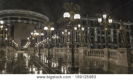 Night light lamppost, refflecting the light of wet path to the baroque building