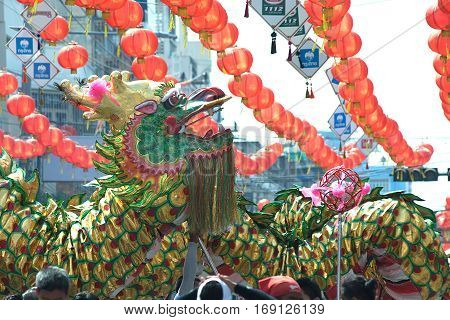 NAKHONSAWAN , THAILAND - JANUARY 31,2017 : Group Parade of Golden dragon show at Middle market in Nakhonsawan city during the Chinese New Year celebrations in Nakhonsawan Province ,Middle of Thailand.