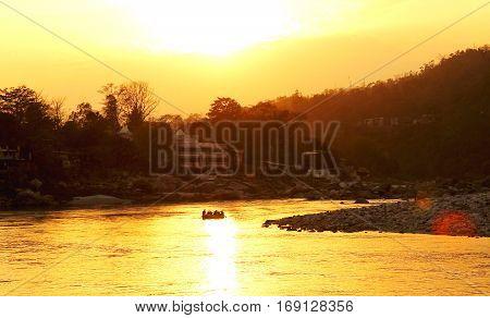 RISHIKESH, INDIA, sunset in Ganga river and boat rafting