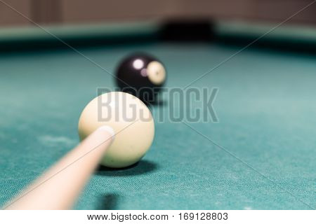 Focus On Cue Aiming Black Ball Into Snooker Billards Pocket