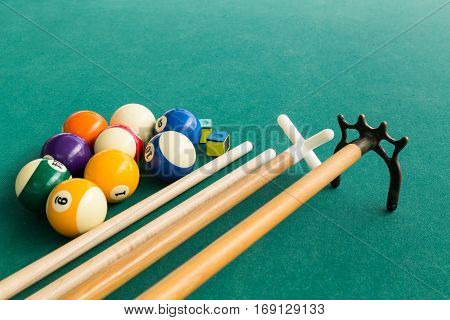 Closeup Of Snooker Billards Balls, Chalk, Cue And Extender Stick