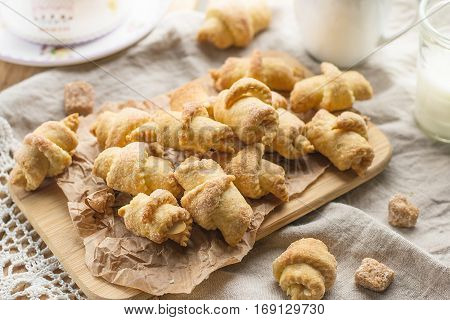 Shortcrust pastry crescent rolls croissants with almonds and brown sugar