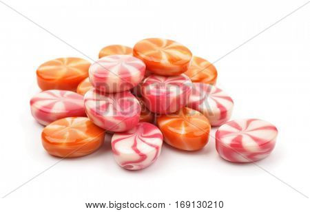 Pile of striped fruit candies isolated on white