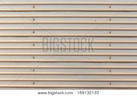 The rustic corrugated grey metal garage door background.