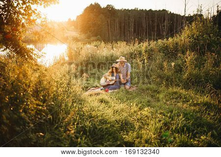 Beautiful couple outdoors on a date at sunset